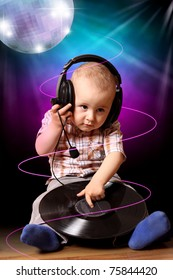 Cute child baby dj in disco