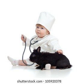 Cute child doctor with pet isolated on white