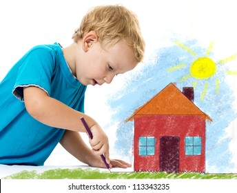 Cute child drawing a house