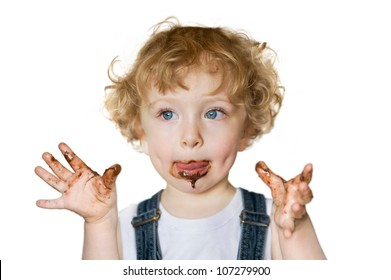 Cute child eating chocolate