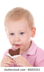 Cute child eating chocolate isolated on white