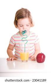 cute child eating drinking orange juice