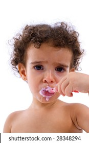 Cute Child eating a sweet with the spoon .