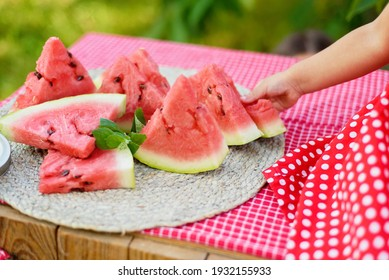 Cute child eats ripe juicy watermelon at summertime. Child, baby, healthy food snack for children.