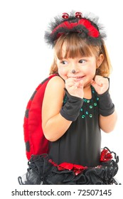 Cute child with Ladybug looking at the side .