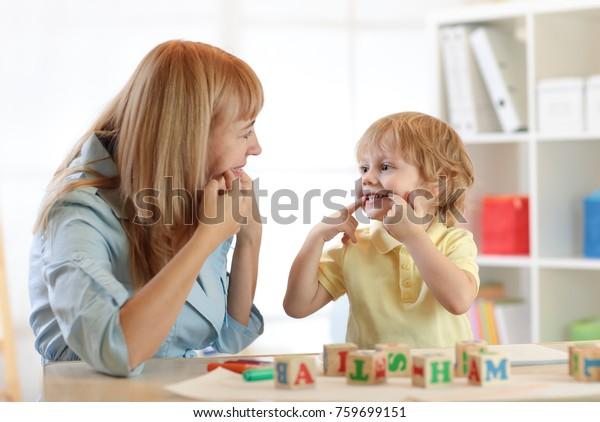Cute child little boy at speech therapist office
