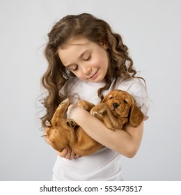 Cute child little girl with puppy isolated on white background. Kid Pet Friendship