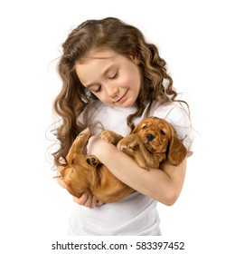 Cute child little girl with red puppy isolated on white background. Kid pet friendship