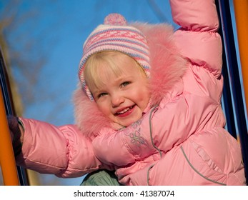 cute child on nursery hutch at winter