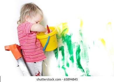 cute child painting over white