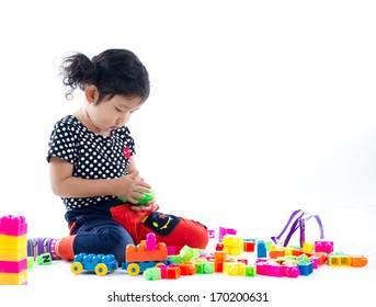 A cute child playing blocks toy on white background, Studio shot.