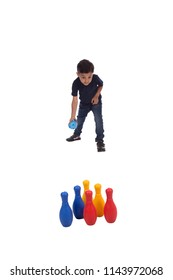 cute child playing bowling and throwing the bowl , isolated on white background