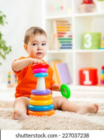 cute child playing with color toy indoor