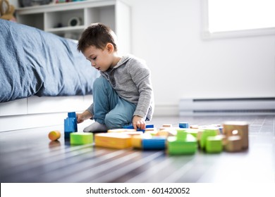 A cute child playing with color toy indoor