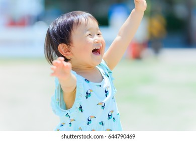 Cute child playing outdoors