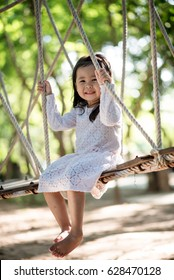 A cute child is playing in the park.
