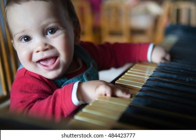 Cute child playing the piano