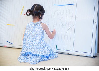 Cute child practicing writing back view