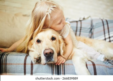 Cute child resting with dog
