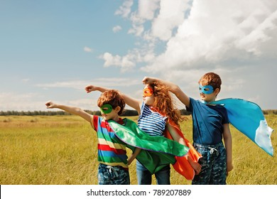 Cute child in Super hero costume. Superhero strong people concept.