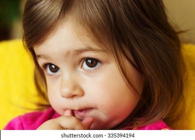 Cute child thinking