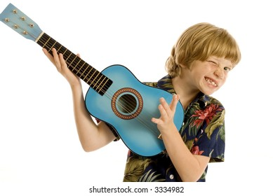 Cute child in tropical outfit playing guitar or ukelele