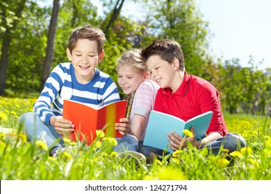 Cute children enjoying reading on a sunny summer day