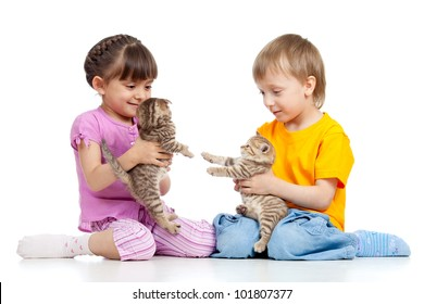Cute children playing with kittens. Isolated on white background