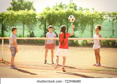 Cute children playing on sports ground outdoors