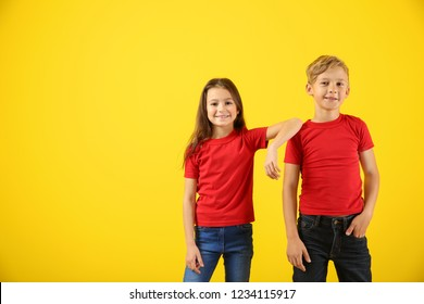 Cute children in t-shirts on color background