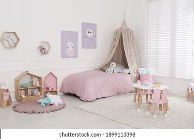 Cute child's room interior with toys and modern furniture