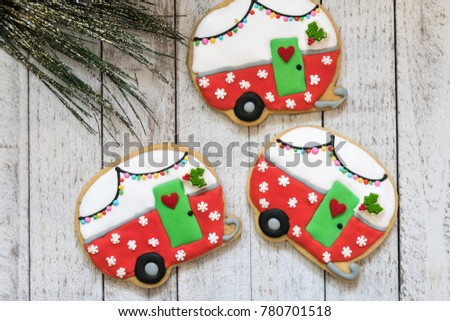cute christmas camper decorated sugar cookies isolated on a whitewashed wood background with garland - Christmas Camper Decoration