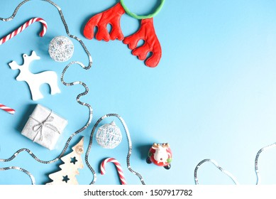 Cute Christmas flat lay on a blue background.
