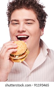 Cute chubby eating a hamburger, isolated on white