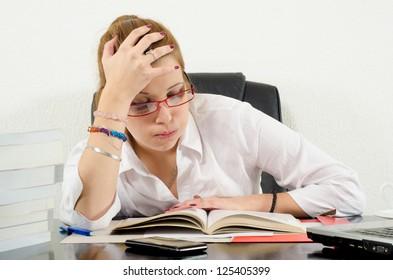 Cute chubby girl preparing for exams.