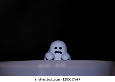 Cute classic white sheeted ghost with black background.