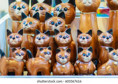 Cute collection of wooden cats, handicraft souvenir from Thailand.