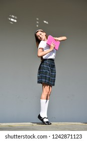 Cute Colombian Female Student And Happiness Wearing School Uniform While Standing