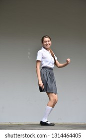 Cute Colombian Teen Girl And Happiness Wearing Skirt Standing