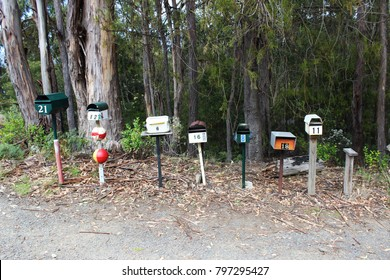 cute colorful letter box stand right beside roadside countryside