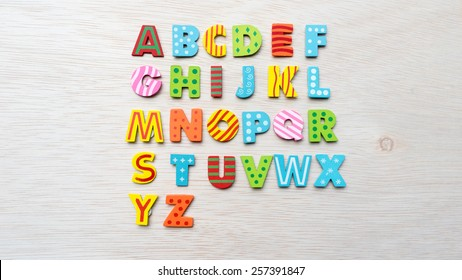 Cute and colorful wooden alphabet letter set. Concept of back to school. Shot with natural light. Slightly defocused and close-up shot. Copy space.