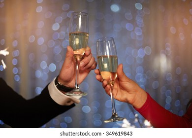 Cute couple celebrate Christmas with champagne