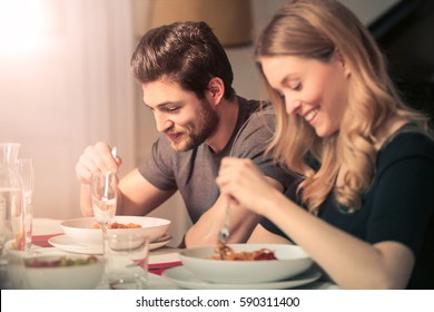 Cute couple eating dinner