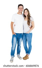Cute couple embracing and looking the camera on white background