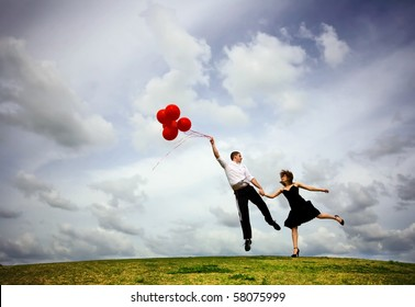 Cute Couple Flying with Red Balloons