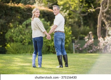 Cute couple holding hands in the garden