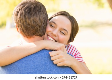 Cute couple hugging in the park on a sunny day