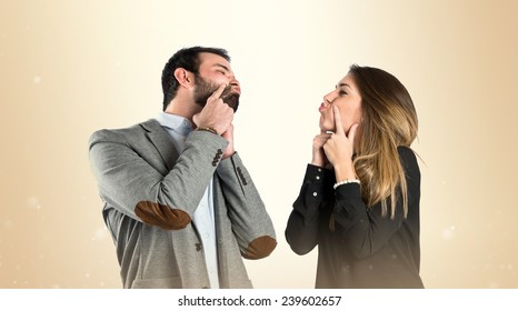 Cute couple over isolated ocher background