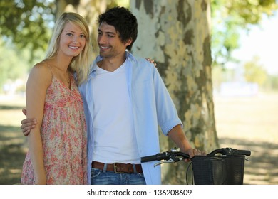 cute couple in park with bike