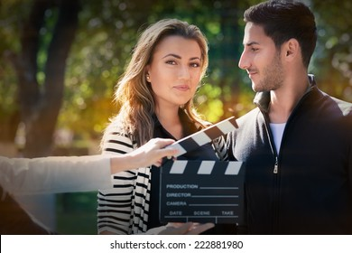 Cute Couple Ready for a Shoot - Young couple shooting a romantic scene outside